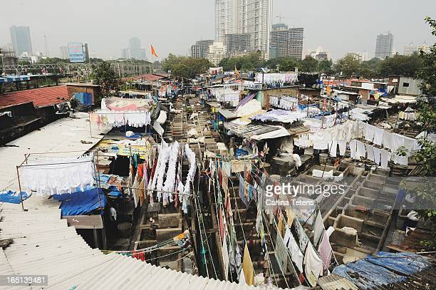 Huge ammounts of laundry from around the City of Mumbai is washed every day at the open-air Dohbi Ghat laundromat by both hand or modern machines.