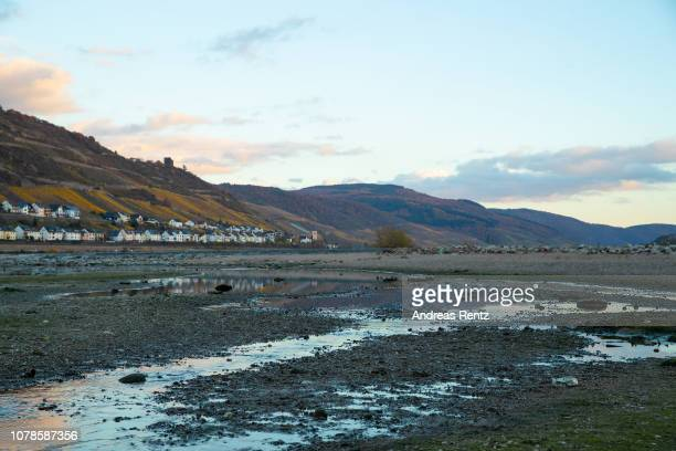 Huge banks and low water in the River Rhine along the vineyards and city of Lorchhausen reflect on the water surface on November 13 2018 in Osterspai...