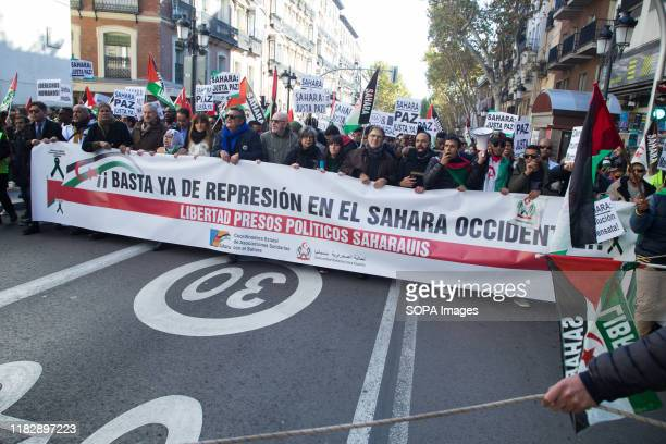 Huge banner saying, Stop repression in Western Sahara during the demonstration. Thousands of Saharawis arrive from all over Spain to demand the end...