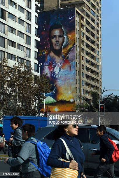 A huge banner with a portrait of Chilean footballer Alexis Sanchez is displayed on the side of a building in Santiago on June 10 2015 on the eve of...