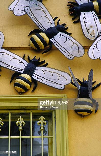 Huge bees rest on a shop facade on Melbourne's Brunswick Street.