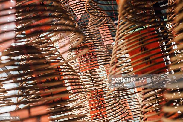 Huge bellshaped coils of incense are seen hanging at the Kwong Fuk Ancestral Hall during the month of Hungry Ghost Festival on August 14 2015 in Hong...