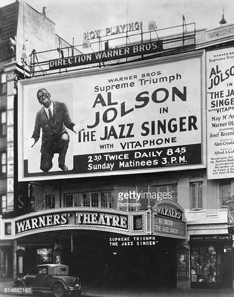 A huge billboard on the side of Warners' Theatre in New York advertises The Jazz Singer the first talkie in 1927