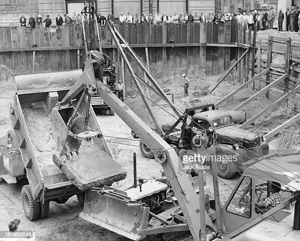 MAY 19 1961 MAY 21 1961 Huge Blocks Stump Excavators Twoton sandstone base blocks that served as support columns for old building at 17th and...