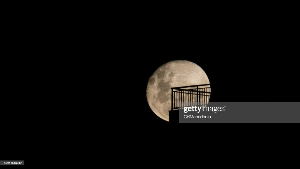 A huge  blood moon  on the home balcony. : Stock Photo