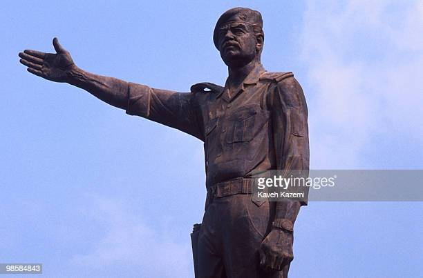 A huge bronze statue of Saddam Hussein stands erect in a square in Baghdad during the Gulf War 20th February 1991
