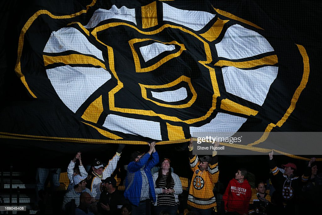 A huge Bruins flag makes its way around the arena : News Photo