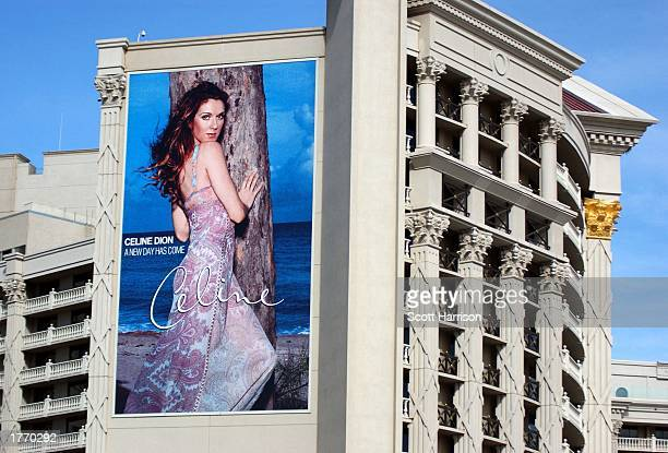 A huge Celine Dion concert advertisment poster hangs February 7 2003 on the side of Caesars Palace in Las Vegas Nevada Dion will perform over 300...