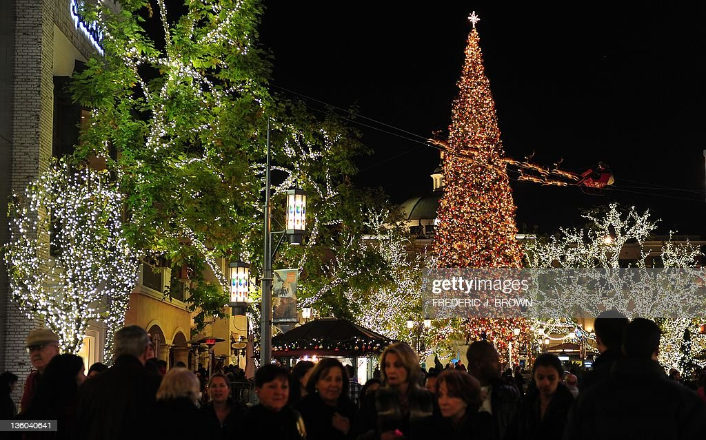 A huge Christmas Tree is decorated and displayed for the festive season in Los Angeles, California, on December 20, 2011. The 110-foot Christmas Tree that is lit every year the the Grove at Farmer's Market is the tallest Christmas Tree in the city of Los Angeles. AFP PHOTO / Frederic J. BROWN