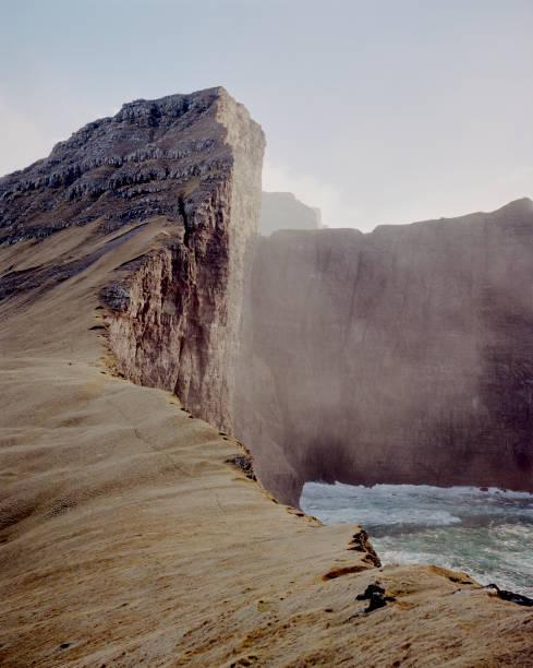 Huge cliffsides near Drangarnir sea stack in the Faroe Islands