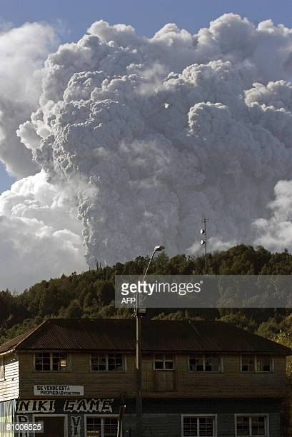 A huge cloud of ash belches from the Chaiten volcano some 1300 km south of Santiago as seen from Chaiten a town where only animals are left after...