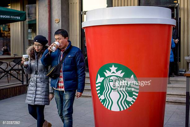 A huge coffee cup outside a Starbucks coffee house Starbucks already has nearly 2000 stores in mainland China and plans to have 3400 by 2019 laying...
