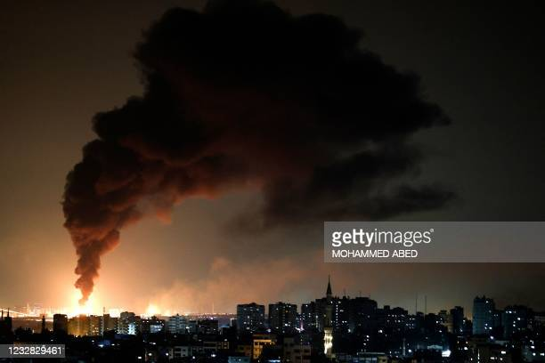 Huge column of smoke seen from Gaza city billows from an oil facility in the southern Israeli city of Ashkelon, on May 11 after rockets were fired by...