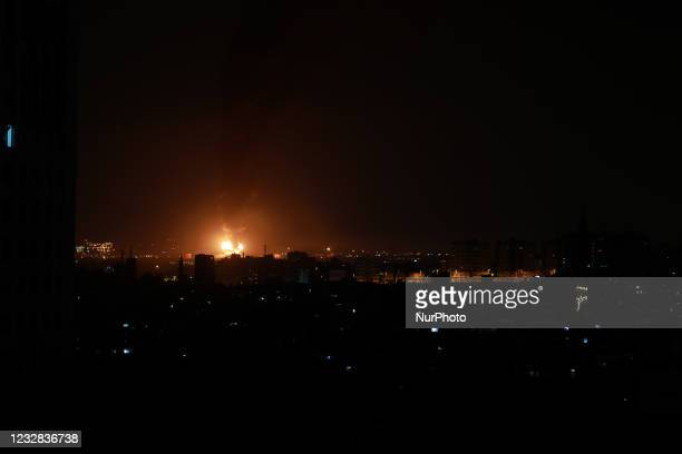 Huge column of smoke seen from Gaza city billows from an oil facility in the southern Israeli city of Ashkelon, on May 12 after rockets were fired by...