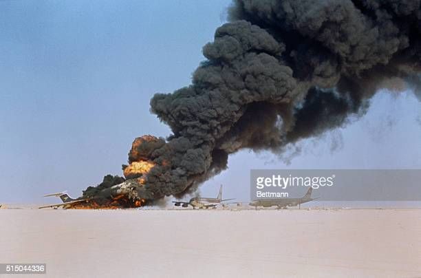 Huge columns of smoke pour from the wreckage of three multimillion dollar international airlines destroyed by Palestine Liberation Organization...