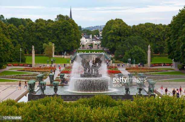huge composite fountain in a green vigeland park in oslo. - gustav vigeland sculpture park stock pictures, royalty-free photos & images