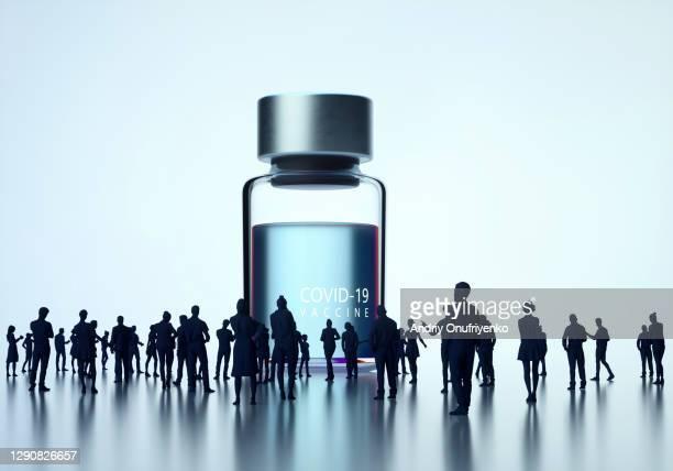 huge covid-19 vaccine bottle appearance. - öffentlicher auftritt stock-fotos und bilder