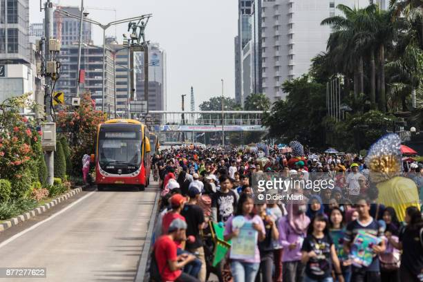 A huge crowd attends the car free day along Sudirman street in Jakarta, Indonesia capital city