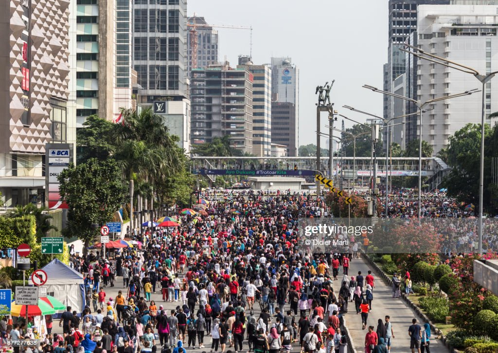 A huge crowd attends the car free day along Sudirman street in Jakarta, Indonesia capital city : Stock Photo