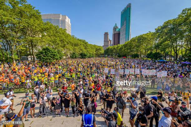A huge crowd gathered at the rally at Cadman Plaza Thousands of New York activists participated in a massive march across the Brooklyn Bridge to...