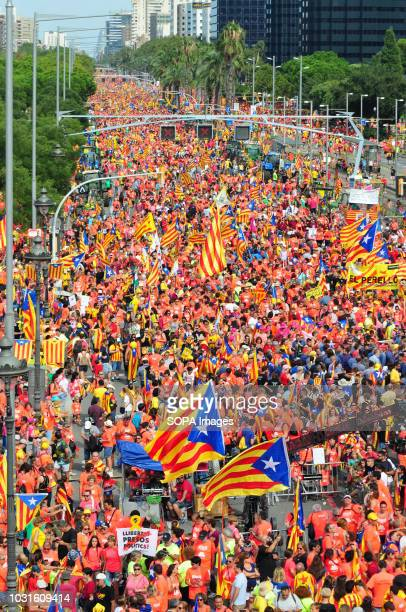 A huge crowd holding flags is seen during the celebration Celebration of the national day of Catalonia where independence and liberation of political...