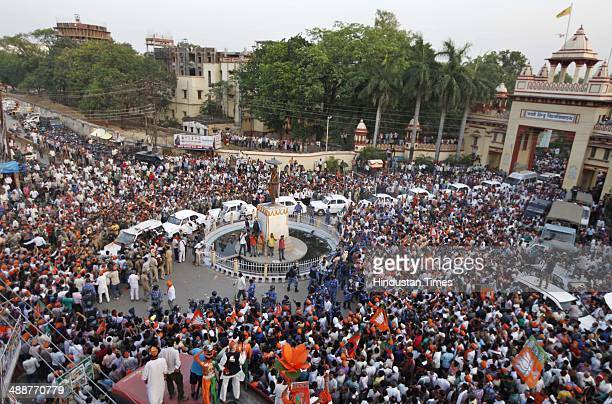 Huge crowd of BJP supporters around the car carrying BJP Prime Ministerial candidate Narendra Modi at BHU as he travels to BJP election office on May...