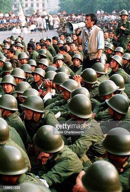 A huge crowd of prodemocracy demonstrators have prevented these soldiers from entering Tiananmen Square just a day before the final bloody nighttime...