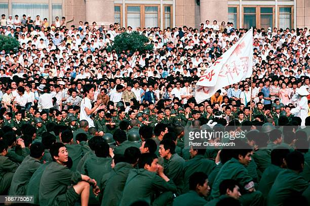 A huge crowd of prodemocracy demonstrators prevent soldiers from entering Tiananmen Square just a day before the final bloody nighttime crackdown on...