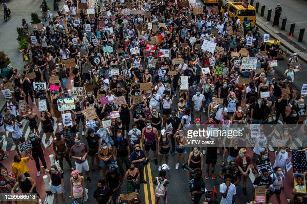Huge crowd of protesters march in downtown New York, NY on July 26, 2020. Hundreds of New York activists participated in a march to condemn what they...