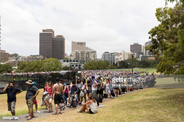 A huge crowd waits at the Domain to enter the viewing area at Mrs Macquarie's Chair on New Year's Eve on December 31 2017 in Sydney Australia 16...