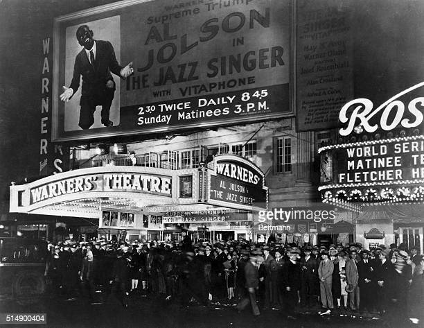 A huge crowd waits outside Warners' Theatre to see Al Jolson in The Jazz Singer