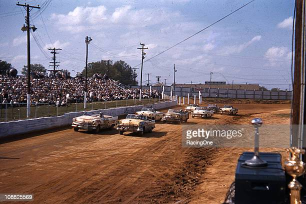 A huge crowd watches a NASCAR Convertible Series race at Greensboro Fairgrounds