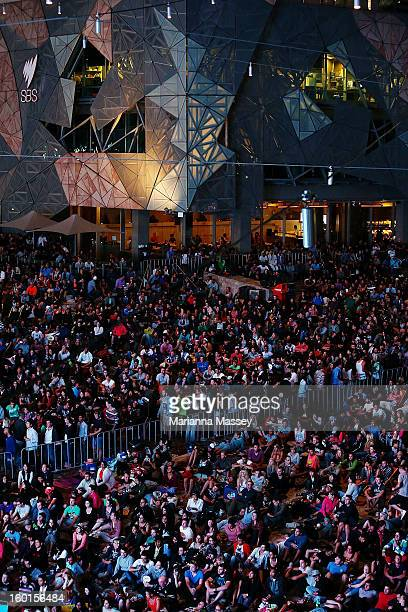 Huge crowds gather at Federation Square to watch the men's final match during day fourteen of the 2013 Australian Open at Melbourne Park on January...