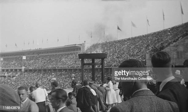Huge crowds inside the 1936 Olympic stadium in Berlin Germany waiting to watch the Summer Olympics officially known as the Games of the XI Olympiad...