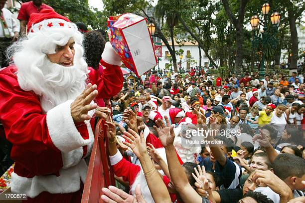 Huge crowds of needy people gather anxiously to receive presents from Santa Claus which were donated by various local Caracas organizations December...