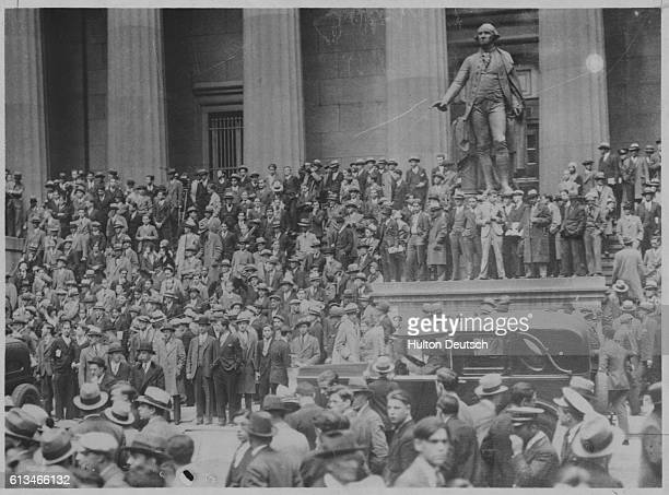 Huge crowds of people gather in front of the SubTreasury Building opposite the New York Stock Exchange during the Great Depression The SubTreasury...