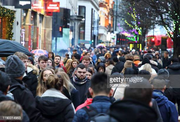 Huge crowds of Shoppers in London's Oxford Street brave the rain and cold to get last minute presents on the finalSaturday before Christmas,.