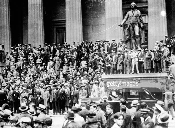 Huge crowds outside the Sub Treasury Building and the statue of George Washington opposite the Stock Exchange New York at the time of the Wall Street...