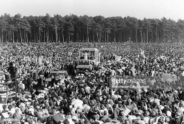 Huge crowds turn out to greet John Paul II's 'popemobile' during his visit to Ireland on September 29 1979