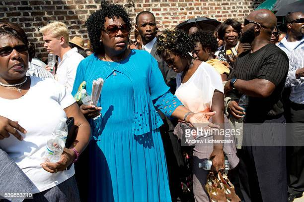 Huge crowds waited in the sweltering heat to attend Reverend and State Senator Pinckney's funeral in downtown Charleston South Carolina Pinckney was...