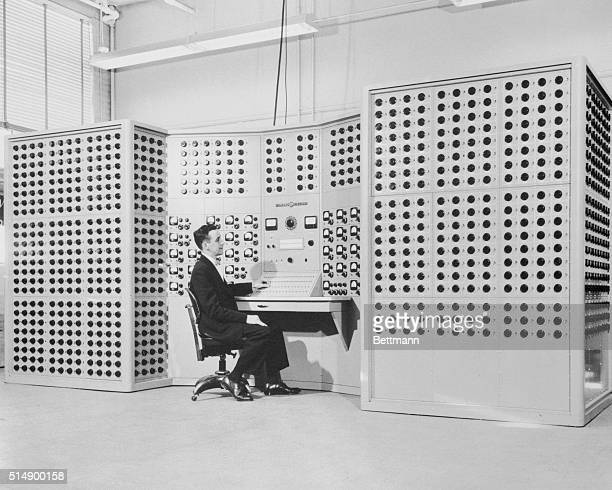Huge dial-studded computer that mathematically models a complex electric power system is given its first test run by K.R Geiser, General Electric...