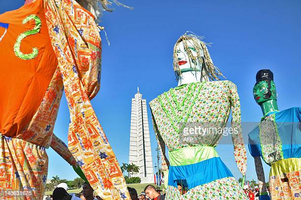 Huge dolls are carried by Cubans marching under the slogan Preserve and Perfect Socialism at Revolution Square in Havana during Labour Day on May 1...