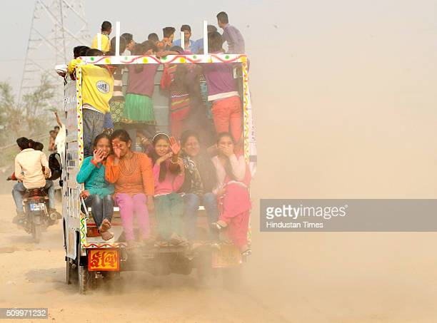 Huge dust blows off road as vehicles ferrying devotees reach banks of river Yamuna for the immersion of idol of Goddess Saraswati during the Vasant...
