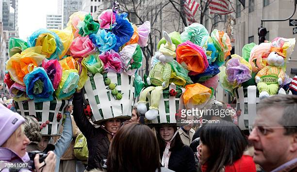 Huge Easter basket hats stand tall above the crowd during the Easter Parade April 8 2007 in New York City The parade of costumes and bonnets has been...