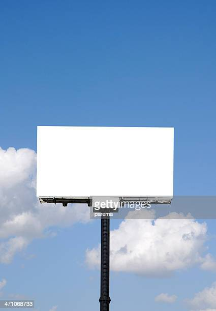 A huge empty white billboard with a view of the sky