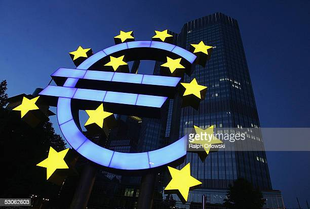 Huge euro logo is seen in front of the headquarters of the European Central Bank on June 13, 2005 in Frankfurt, Germany. The German economy was...