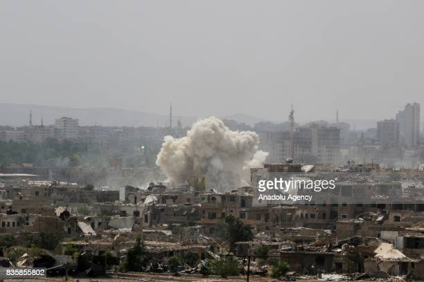 A huge explosion sends clouds into the air after Assad Regime's forces carried out air and ground strikes over the deconflict zone Cobar district in...