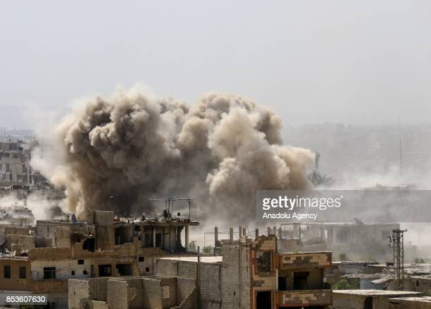 A huge explosion sends clouds into the air after Assad Regime's forces carried out air strikes over the deconflict zone Jobar district in the Eastern...
