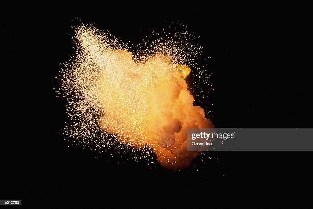 Huge fireburst exploding with emanating sparks : Stock Photo