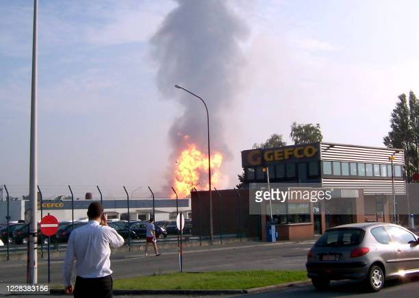 Huge flames are seen as fire rages on the scene of a violent gas explosion 30 July 2004 in Ghislenghien near Ath southern Belgium At least 15 people...